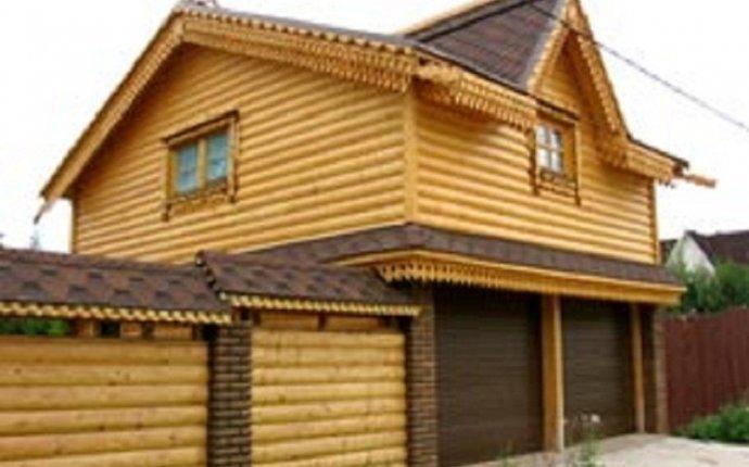 Оцилиндрованные дома с гаражом и коттеджи из бревна с гаражом